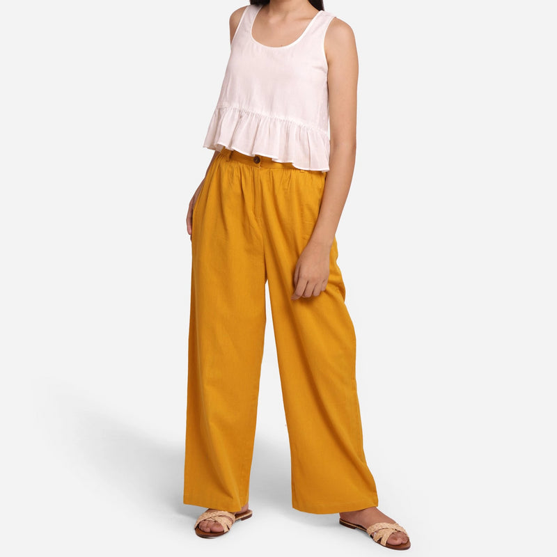 Front View of a Model wearing Mustard Wide-Legged Pants