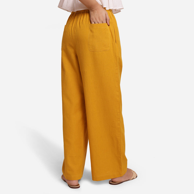 Back View of a Model wearing Mustard Wide-Legged Pants