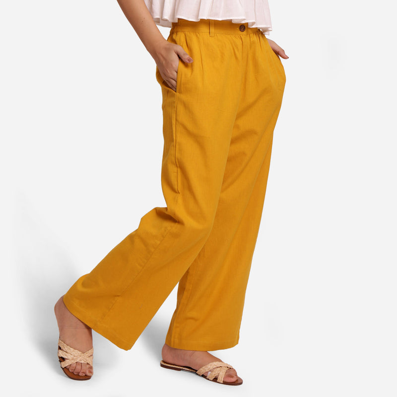 Right View of a Model wearing Mustard Wide-Legged Pants