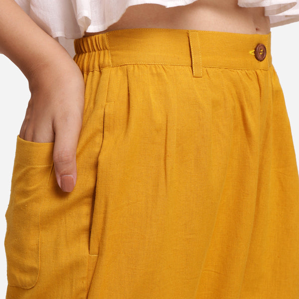 Right Detail of a Model wearing Mustard Wide-Legged Pants
