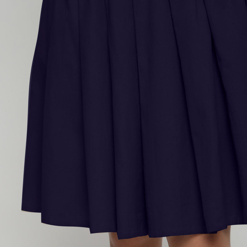Front Detail of a Model wearing Navy Blue Cotton Flax Pleated Skirt