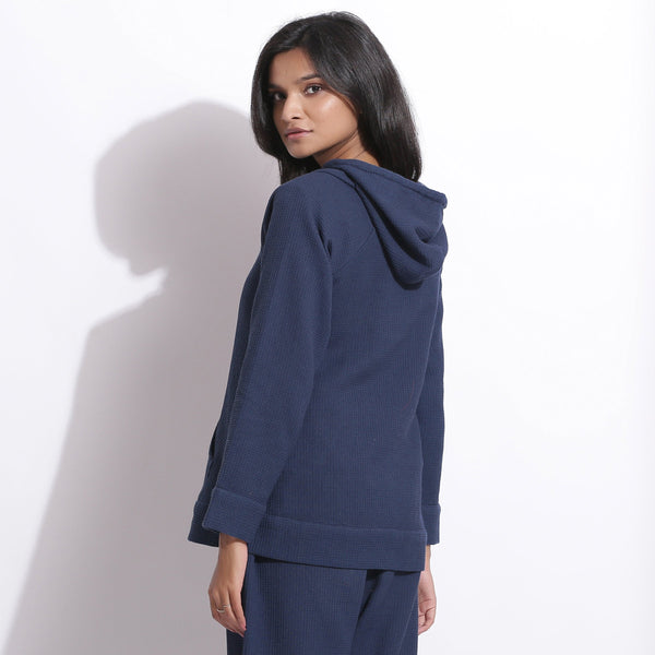 Back View of a Model wearing Navy Blue Cotton Waffle Hoodie Sweatshirt