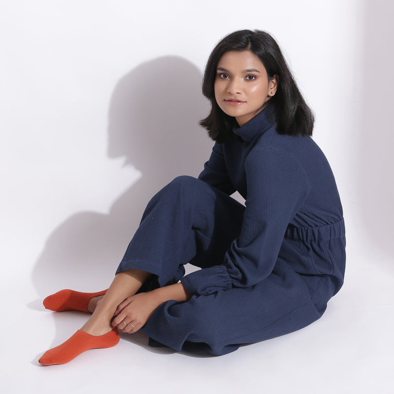Left View of a Model wearing Navy Blue Cotton Waffle Turtle Neck Overalls