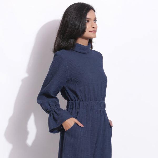 Right View of a Model wearing Navy Blue Cotton Waffle Turtle Neck Overalls