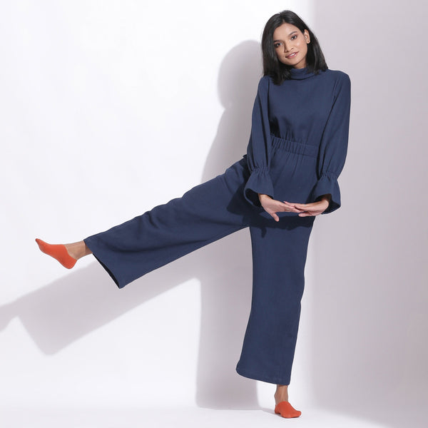 Front View of a Model wearing Navy Blue Cotton Waffle Turtle Neck Overalls