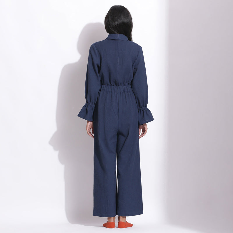 Back View of a Model wearing Navy Blue Cotton Waffle Turtle Neck Overalls