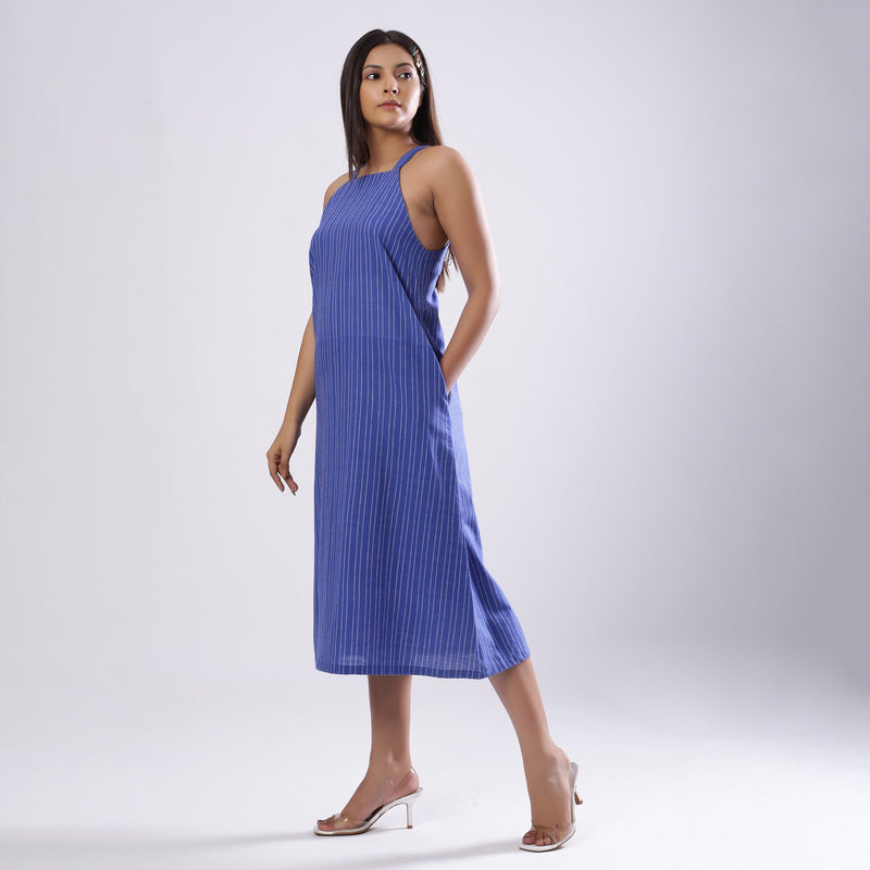 Left View of a Model wearing Navy Blue Handspun Slit Slip Dress