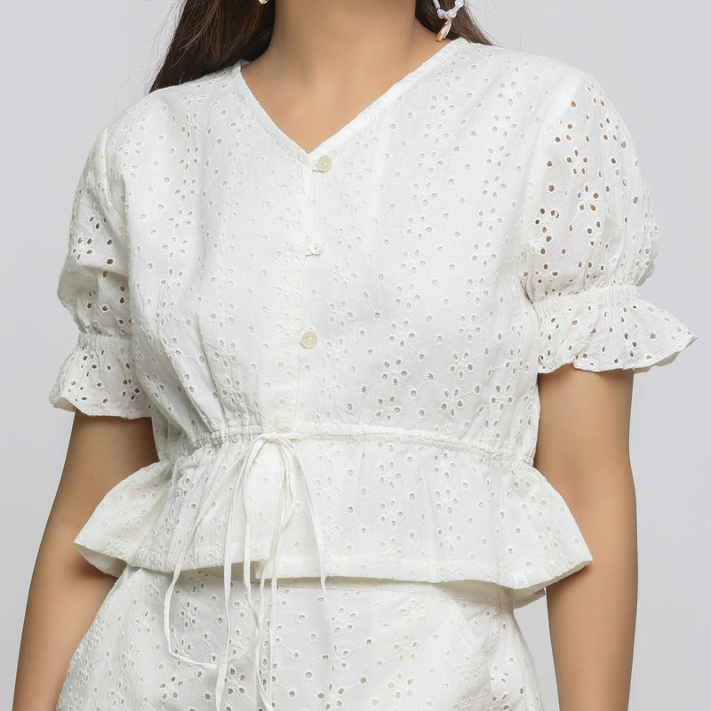 Front Detail of a Model wearing Off-White Cotton Schiffli Floral Top