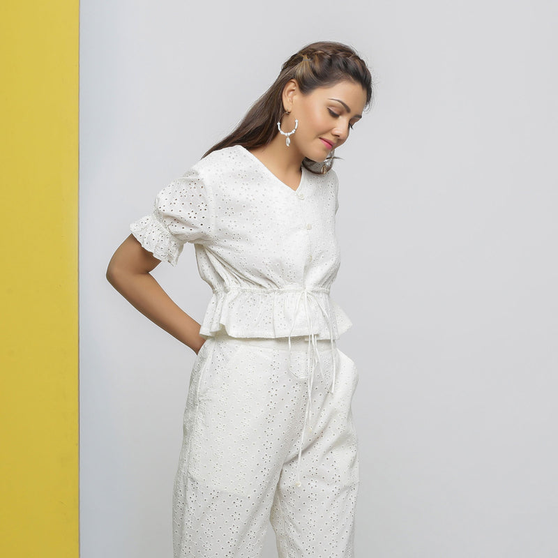 Right View of a Model wearing Off-White Cotton Schiffli Button-Down Top