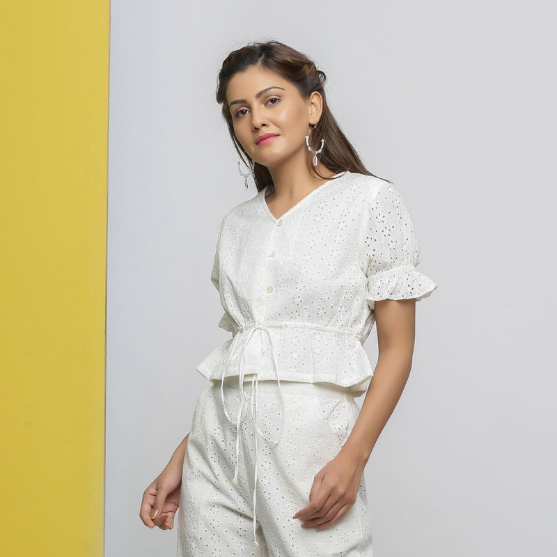 Left View of a Model wearing Off-White Cotton Schiffli Button-Down Top