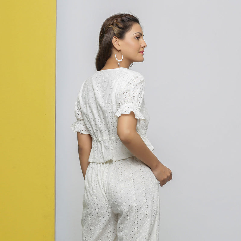 Back View of a Model wearing Off-White Cotton Schiffli Floral Top