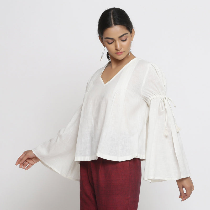 Left View of a Model wearing Off-White Cotton Slub Solid V-Neck Top