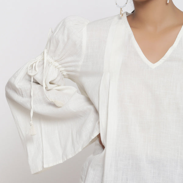 Front Detail of a Model wearing Off-White Cotton Slub V-Neck Flared Top