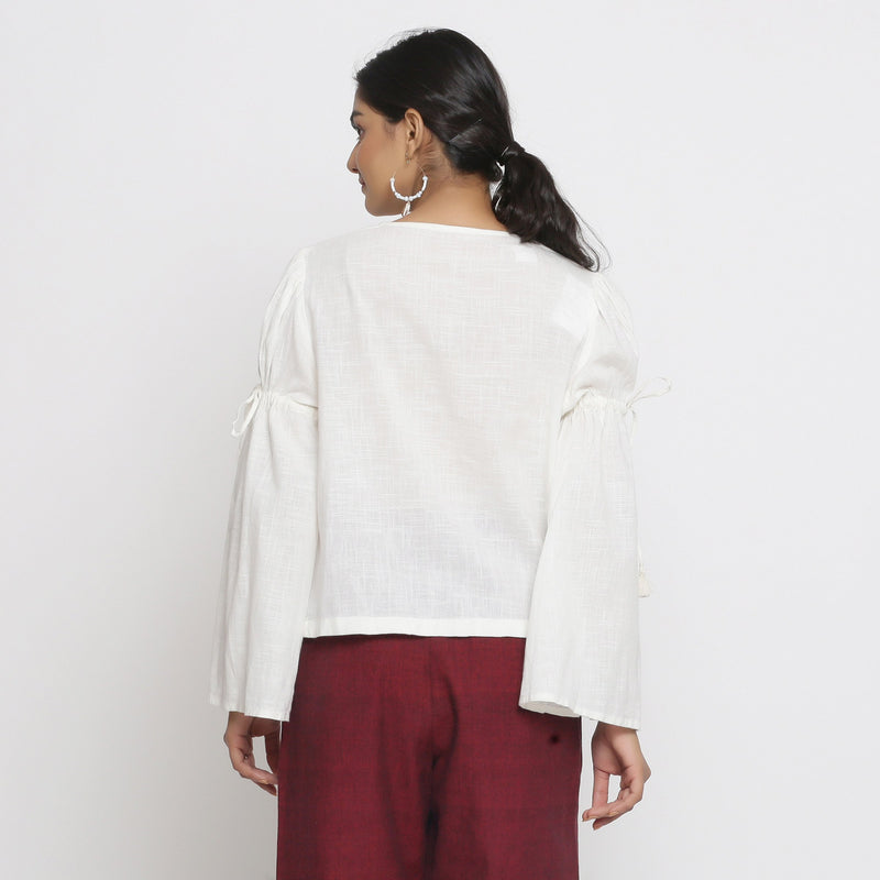 Back View of a Model wearing Off-White Cotton Slub Solid V-Neck Top