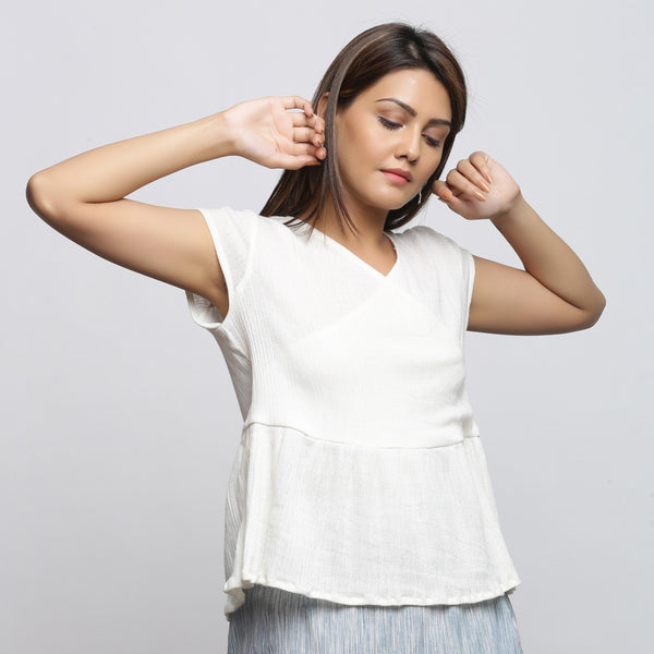 Right View of a Model wearing Off-White Crinkled Cotton Wrap Top