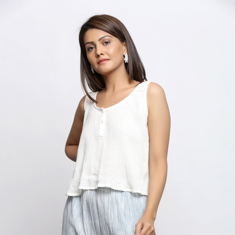 Left View of a Model wearing Off-White Crinkled Cotton Straight Top