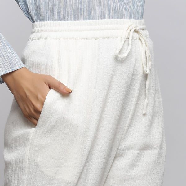 Right Detail of a Model wearing Off-White Crinkled Cotton Tapered Pant