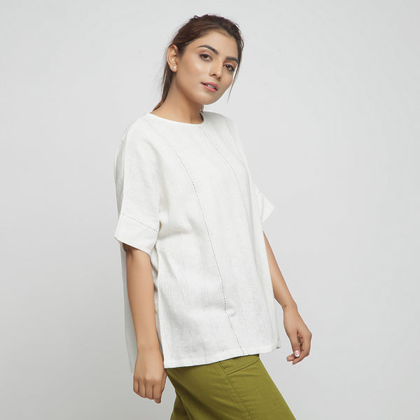 Right VIew of a Model wearing Off-White Hand Embroidered Tunic Top