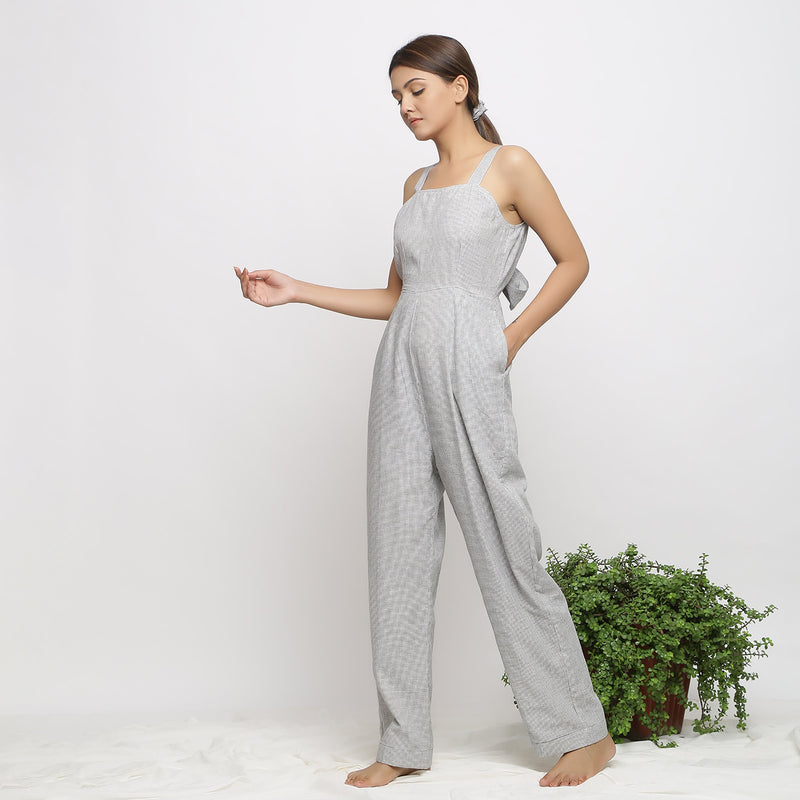 Left View of a Model wearing Off-White Handwoven Cotton Jumpsuit