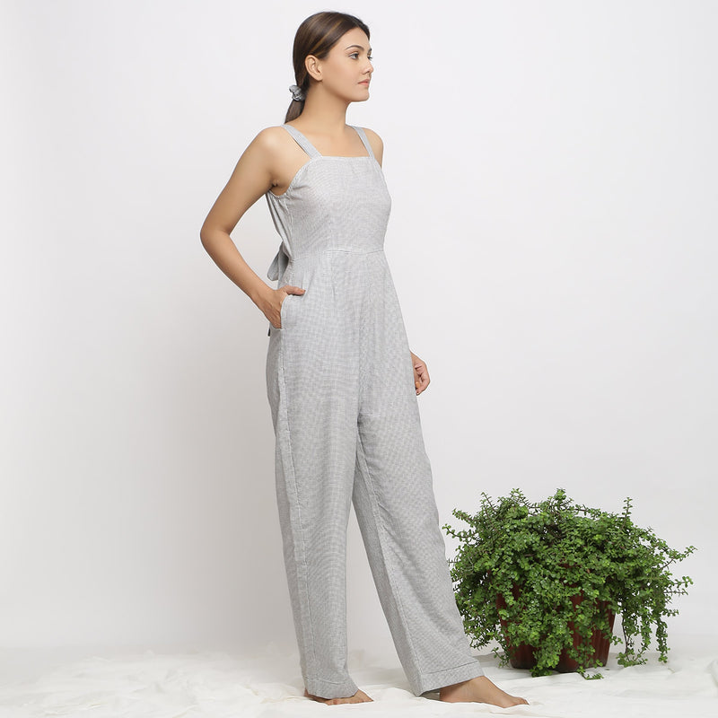 Right View of a Model wearing Off-White Handwoven Cotton Jumpsuit