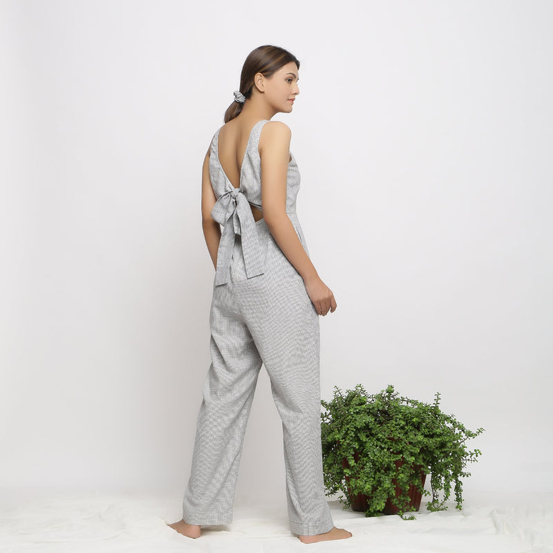 Back View of a Model wearing Off-White Handwoven Cotton Jumpsuit