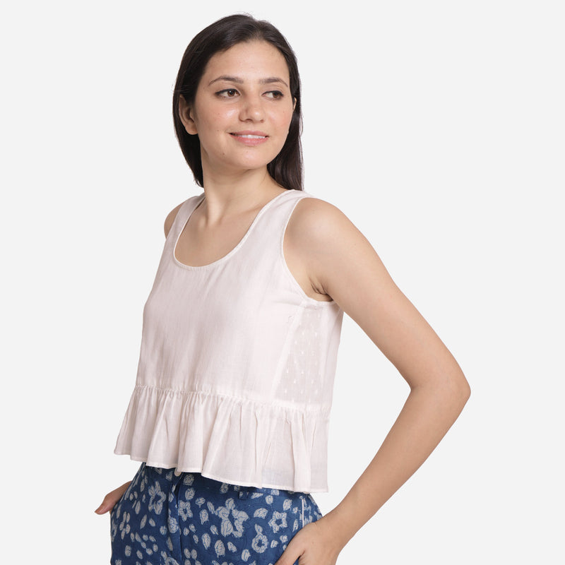 Left View of a Model wearing White Round Neck Cotton Peplum Top