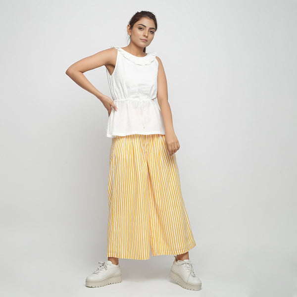 Off-White Peplum Top and Wide Legged Pant Set