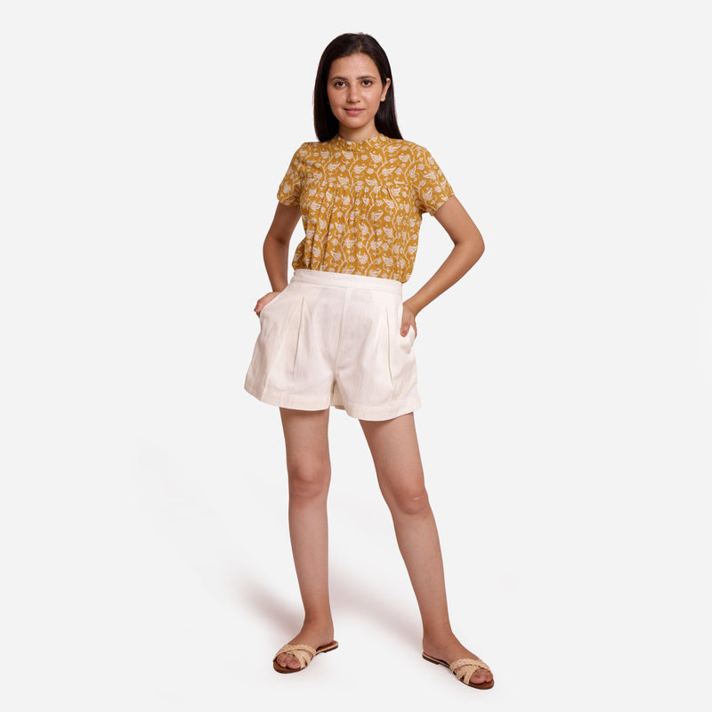 Front View of a Model wearing Off-White Striped Mid-Rise Shorts