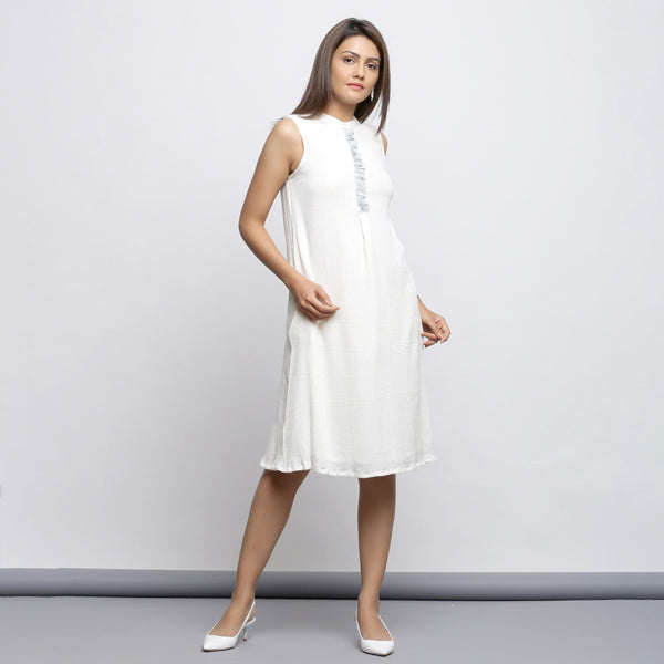 Right View of a Model wearing Off-White Button-Down Shift Dress