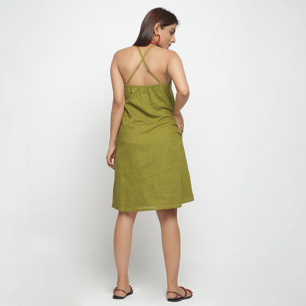 Back View of a Model wearing Olive Green Cotton Criss-Cross A-Line Dress
