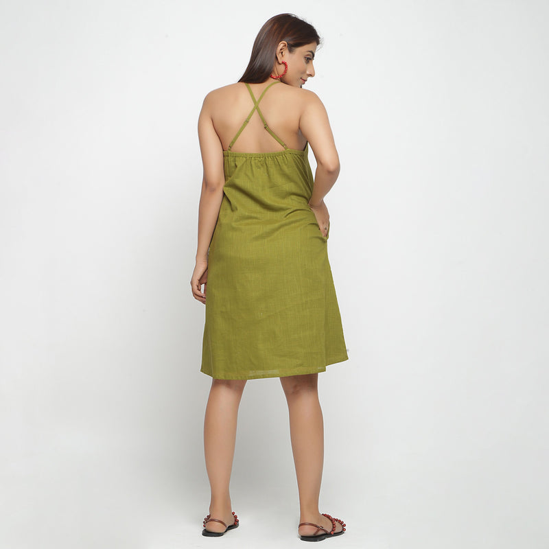 Back View of a Model wearing Olive Green Criss-Cross Cotton A-Line Dress