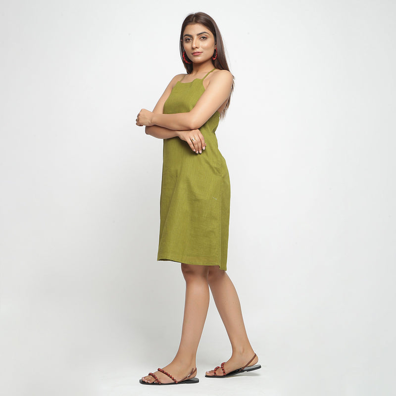 Left View of a Model wearing Olive Green Criss-Cross Cotton A-Line Dress