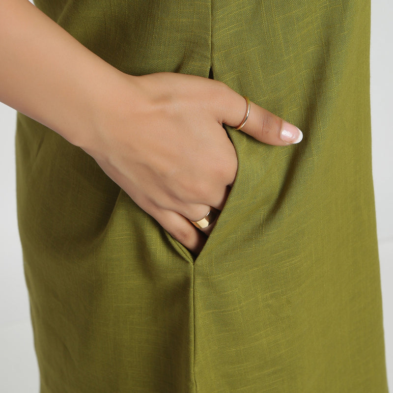 Right Detail of a Model wearing Olive Green Criss-Cross Cotton A-Line Dress