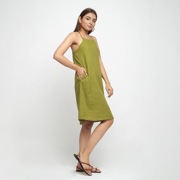Right View of a Model wearing Olive Green Cotton Criss-Cross A-Line Dress