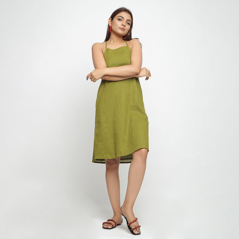 Front View of a Model wearing Olive Green Criss-Cross Cotton A-Line Dress