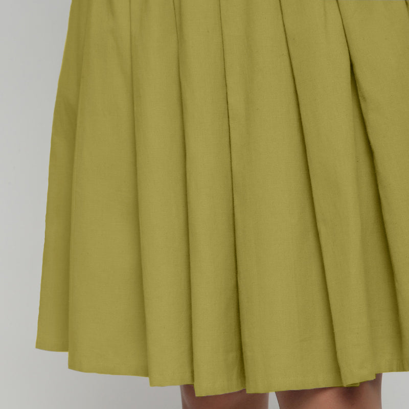 Front Detail of a Model wearing Olive Green Cotton Flax Pleated Skirt