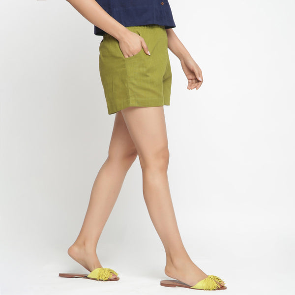 Right View of a Model wearing Olive Green Cotton Flax Short Shorts