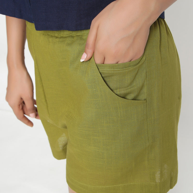 Left Detail of a Model wearing Olive Green Cotton Flax Short Shorts