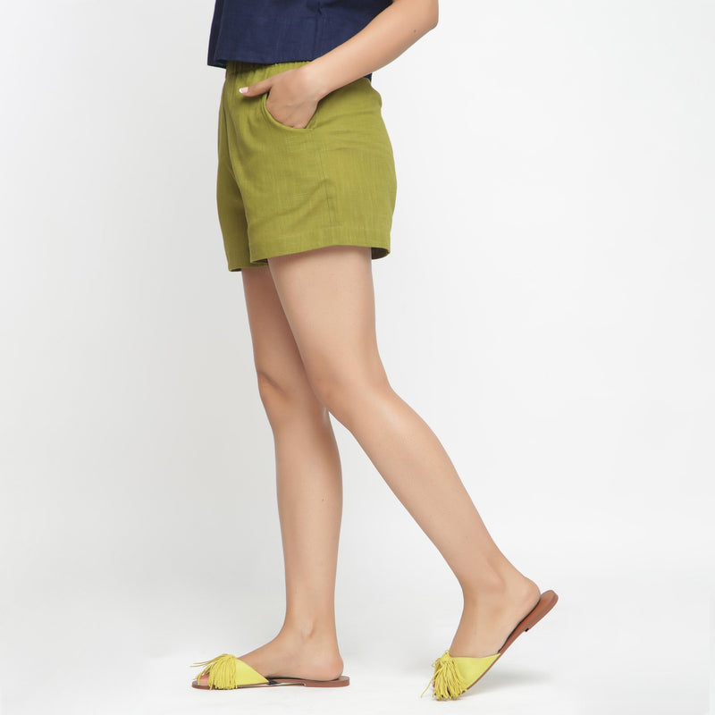 Left View of a Model wearing Olive Green Cotton Flax Short Shorts