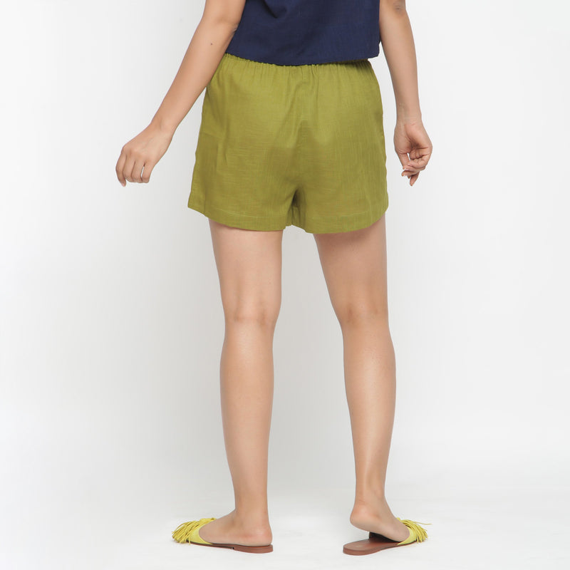 Back View of a Model wearing Olive Green Cotton Flax Short Shorts