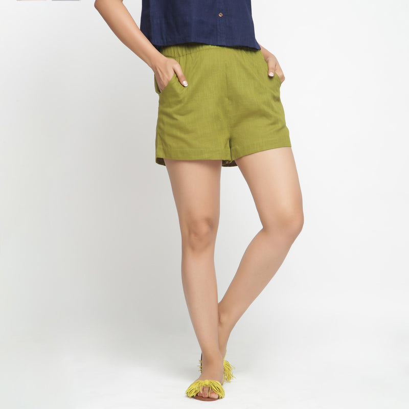 Front View of a Model wearing Olive Green Cotton Flax Short Shorts