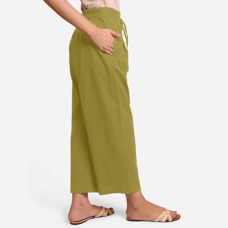 Right View of a Model wearing Olive Green Cotton Flax Wide Legged Pant
