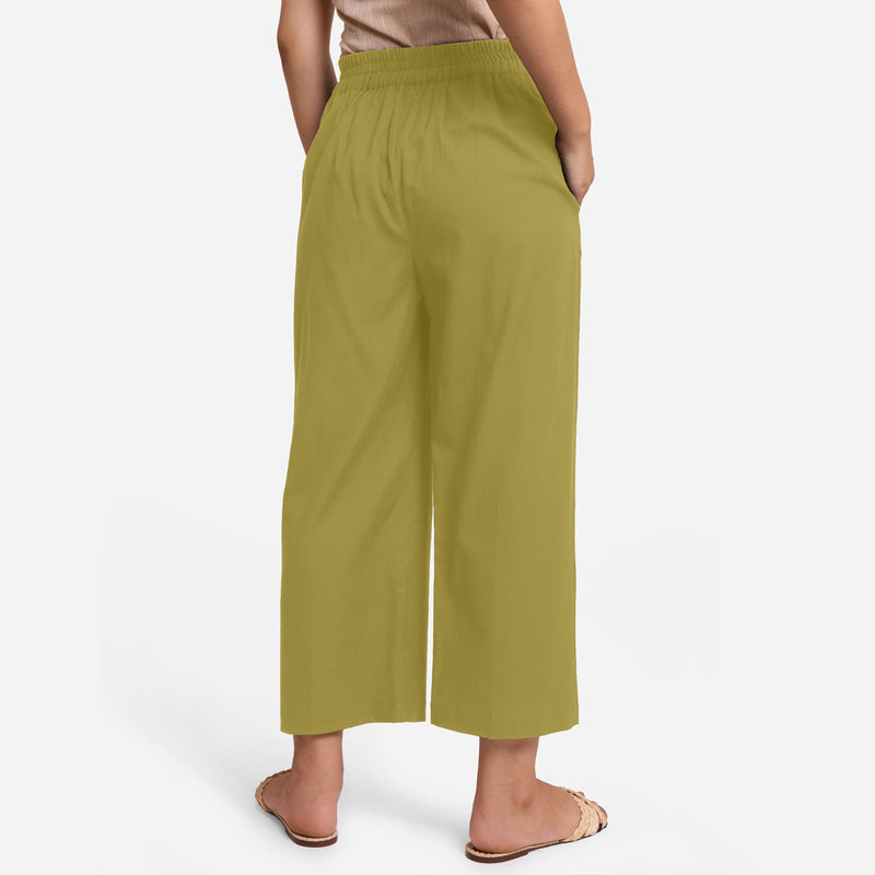 Back View of a Model wearing Olive Green Cotton Flax Wide Legged Pant