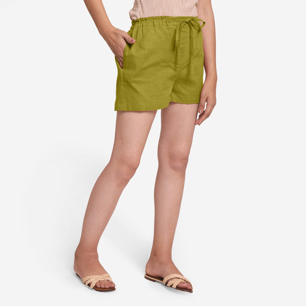 Right View of a Model wearing Olive Green Cotton Straight Shorts