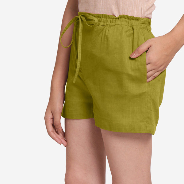 Left View of a Model wearing Olive Green Cotton Straight Shorts