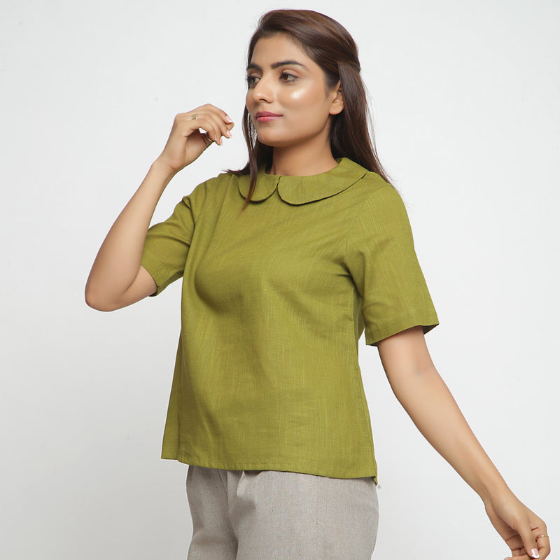 Left View of a Model wearing Olive Green Everyday Essential A-Line Top