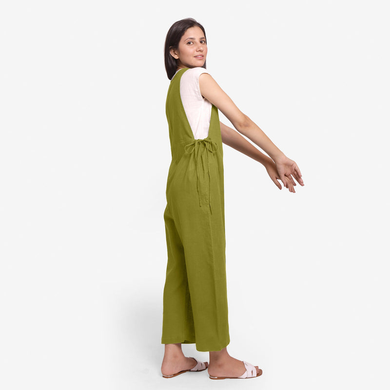 Left View of a Model wearing Olive Green Waist Tie Up Pinafore Jumpsuit