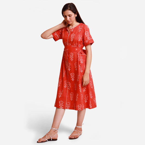 Left View of a Model wearing Orange Dabu Block Print A-Line Midi Dress