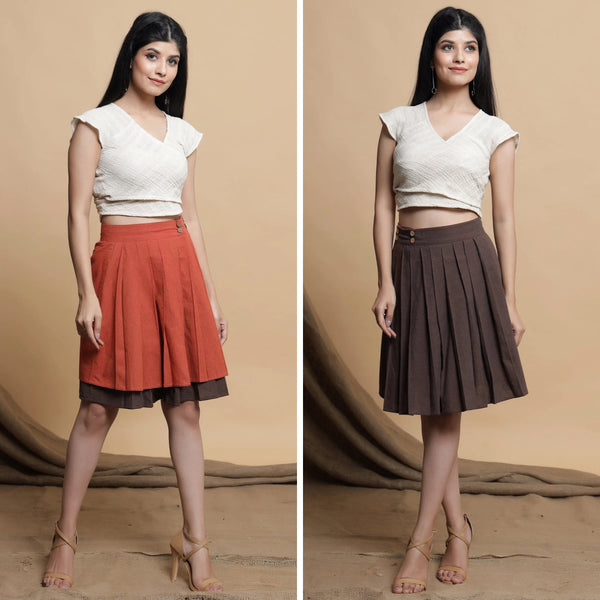 Front View of a Model wearing Orange and Brown Reversible Pleated Flared Skirt