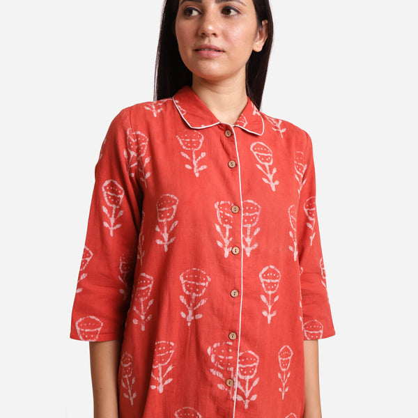 Front Detail of a Model wearing Dabu Hand Block Print Orange Button-Down Dress